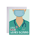 Greeting Card with Cartoon drawing of a doctor with a mask, scrubs and stethoscope. Reads A Real Hero Wears Scrubs