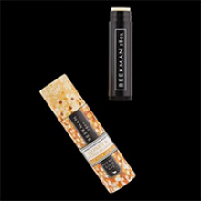 image of Honey & Orange Blossom Lip Balm with out of packaging with cap off