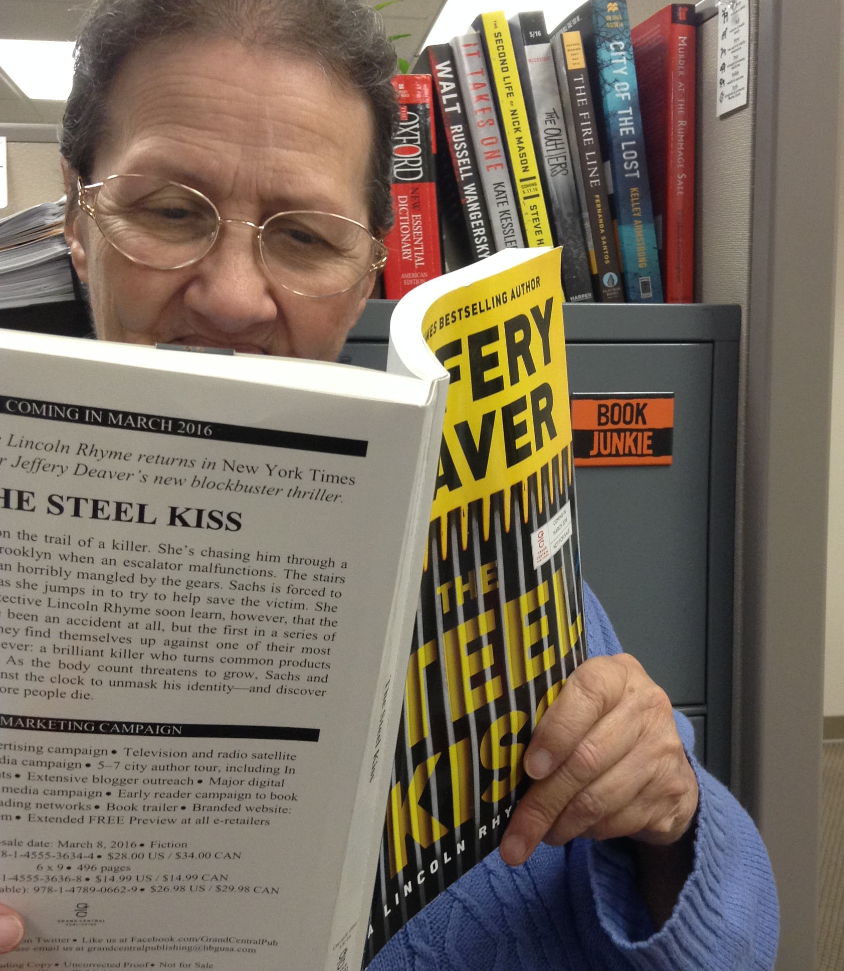 """Photo of Lee reading a copy of """"The Steel Kiss"""""""