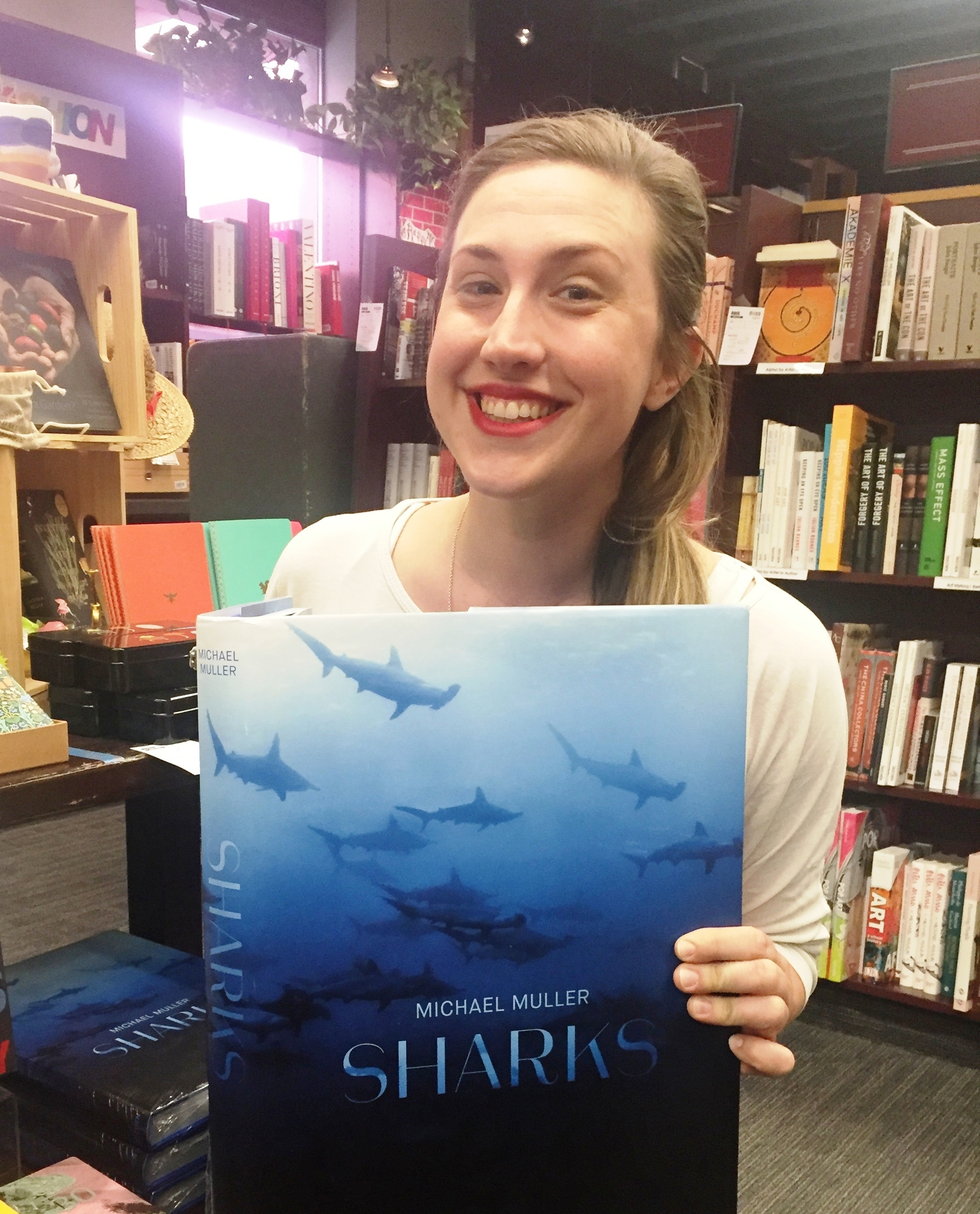 "Photo of Sarah reading a copy of ""Sharks"""