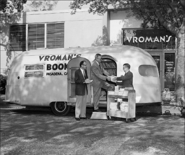 Black and white photo of the Vroman's Book Mobile parked outside the old storefront