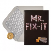 Image of black greeting card with Mr. Fix It on the front in duct tape