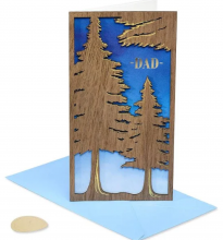 image of greeting card with cut out wooden trees on the front