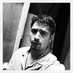 Black and white photo of Josh posing