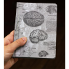 image of Brain Anatomy Mini Hardcover Dot Grid Journal in hand for scale